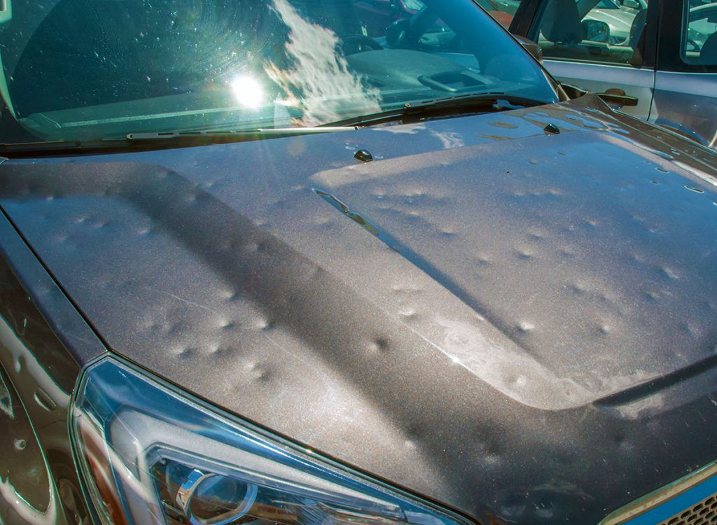 Hail Damage on Grey Car