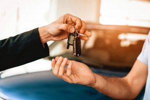 Keys being handed over when trading in vehicle