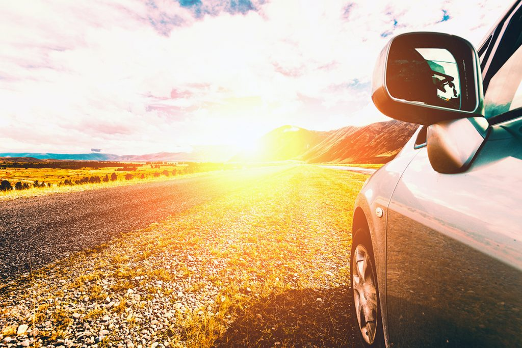 Vehicle driving on road during summertime